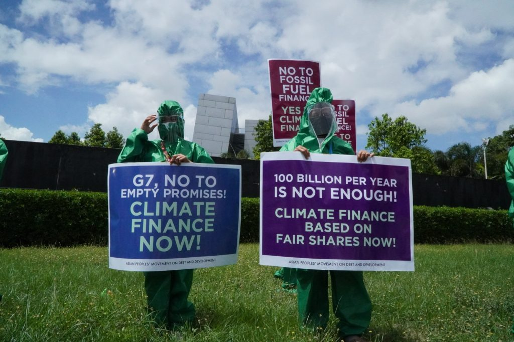 Image of activists and climate finance